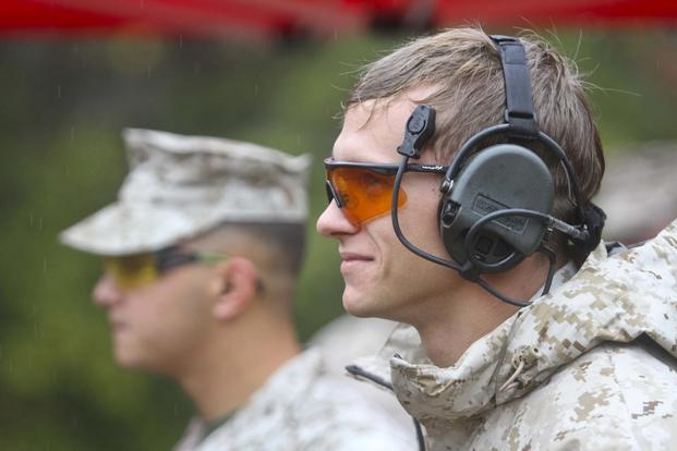 Cpl. David Dudley, Expeditionary Air Field, uses proper eye and ear protection during the 5th annual Combat Shooting Competition Oct. 28, hosted by Weapons Training Battalion aboard Marine Corps Base Quantico. (U.S. Marine Corps/Ida Irby)