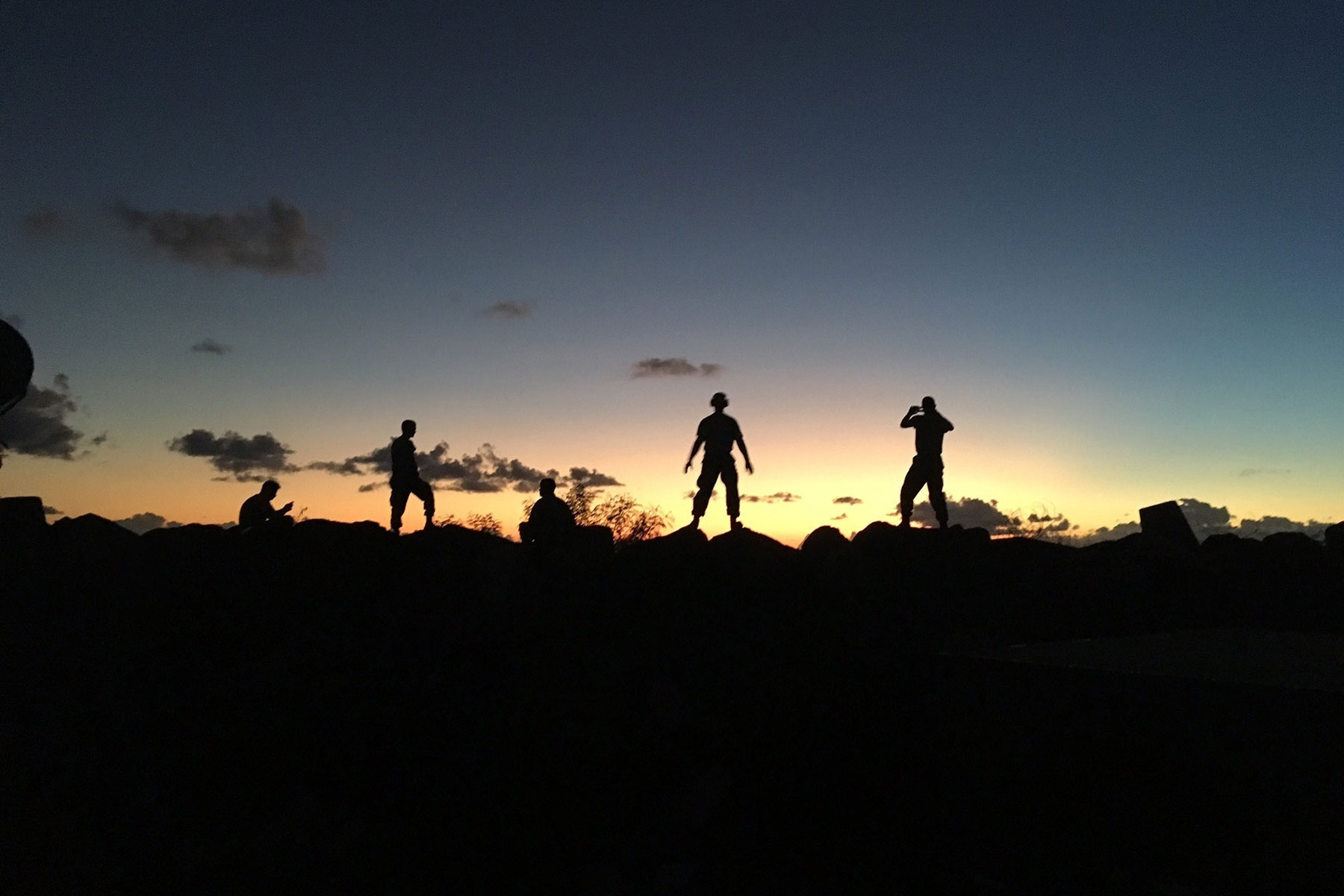 The North Carolina National Guard's 145th Logistics Readiness Squadron (LRS) Small Air Terminal team stands in the Caribbean sunset during their mission to the U.S Virgin Islands. (North Carolina National Guard)