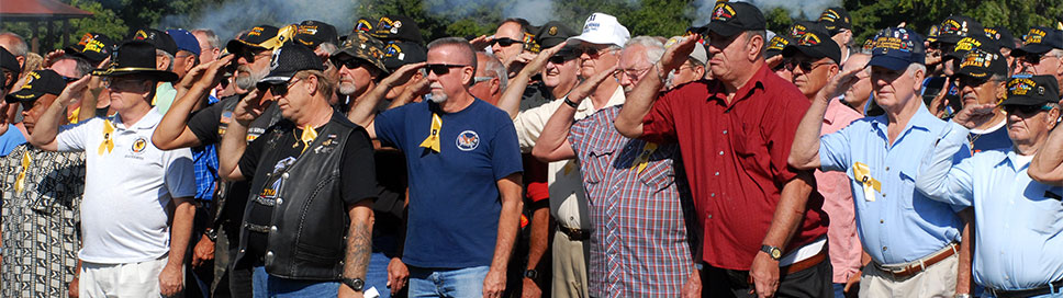 Vietnam veterans stand during a 15-shot salute on Fort Knox, Kentucky. (U.S. Army)