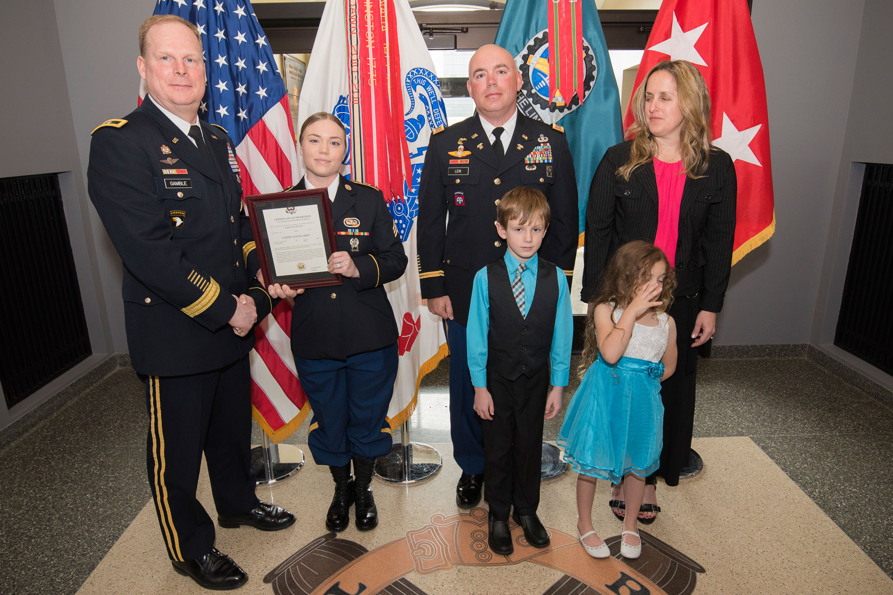 army promotes father  daughter on same day