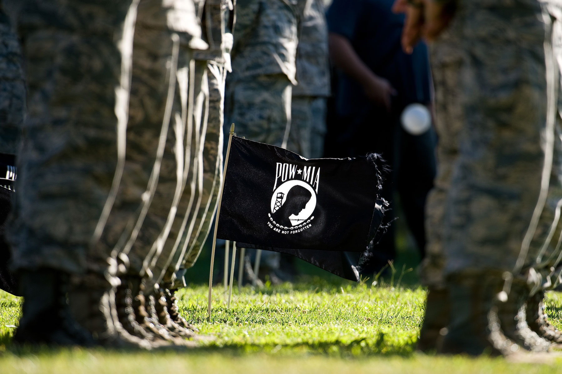 Twenty POW/MIA flags wave in a steady breeze during a retreat ceremony commemorating National POW/MIA Recognition Day Sept. 16, 2016, on Dover Air Force Base, Del. (U.S. Air Force photo by Roland Balik)
