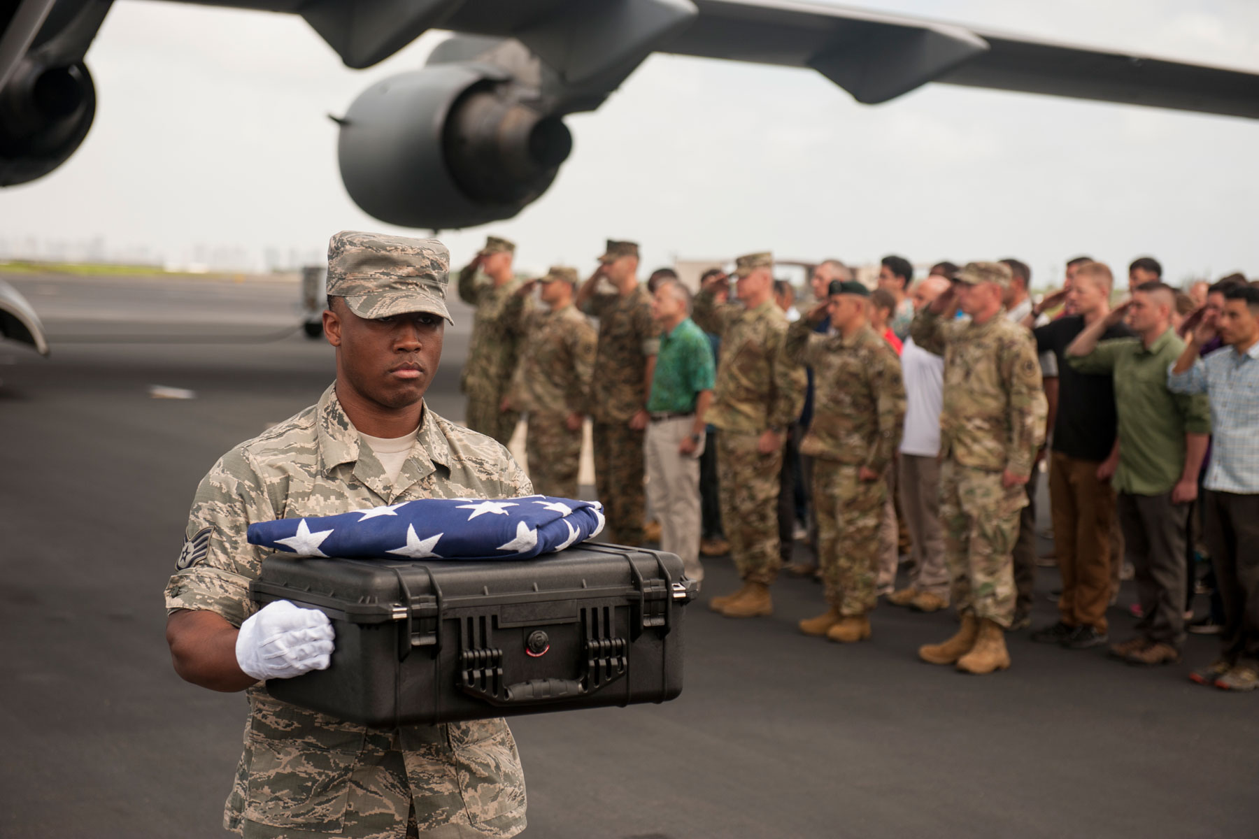 U.S. Air Force Staff Sgt. Sedric Franklin, an analyst with the Defense POW/MIA Accounting Agency (DPAA), carries a transfer case during a solemn movement at Joint Base Pearl Harbor-Hickam, Hawaii, April 15, 2018. (U.S. Air Force photo by Staff Sgt. Matthew J. Bruch)