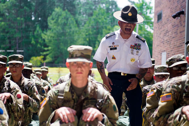A U.S. Army Drill Sergeant assigned to Foxtrot 1st Battalion 34th Infantry Regiment directs trainees on the First day of Basic Combat Training on June 12, 2017 at Fort Jackson, SC. (U.S. Army photo/Spc. Darius Davis)