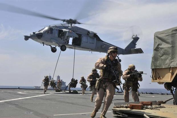 Marines from the 22nd MEU fast rope to the flight deck from a MH-60S Sea Hawk helicopter during an exercise aboard the USS Whidbey Island. Mass Communication Specialist 3rd Class Desiree D. Green/Navy