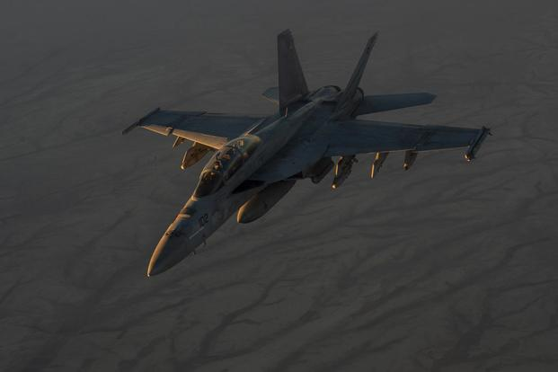 A U.S. Navy F/A-18 flies in formation after conducting aerial refueling operations with a KC-135 Stratotanker over Syria on Oct. 18, 2017. Sen. Joni Ernst has introduced a bill calling for the Navy to report on its efforts to solve pilot hypoxia incidents. Tech. Sgt. Gregory Brook/Air Force