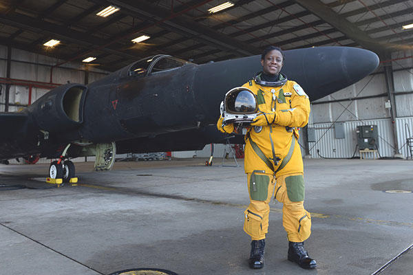 Air Force Lt. Col. Merryl Tengesdal stands in front of a U-2 at Beale Air Force Base, Calif., Feb. 9, 2015. (U.S. Air Force/Senior Airman Bobby Cummings)