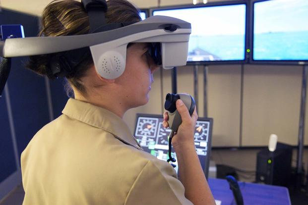 A Surface Warfare Officer's School (SWOS) student navigates a virtual vessel through a number of simulated hazards in the school's full-mission bridge. (U.S. Navy/Mass Communication Specialist 2nd Class Jason McCammack)
