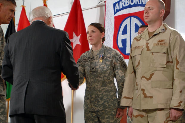 Spc. Monica Brown gets awarded the Silver Star at Bagram Airfield, Afghanistan, by Vice President Dick Cheney for her actions on April 25, 2007, during a combat patrol. (U.S. Army/Scott Davis)
