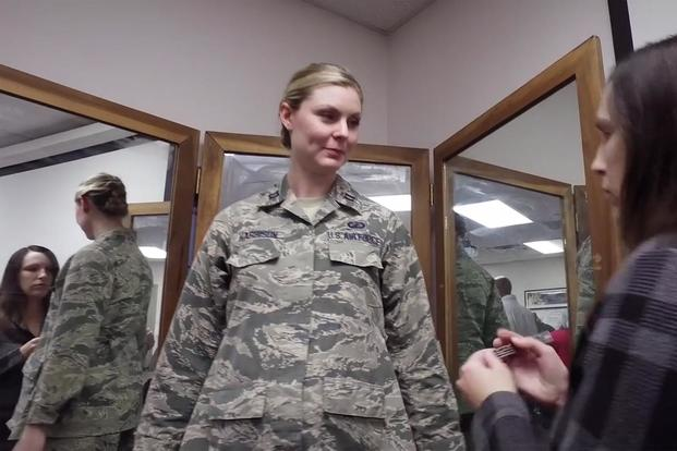 The Air Force Uniform Office, located at Wright-Patterson Air Force Base, OH., has released the newest version of the Maternity Airman Battle Uniforms. (Screen grab from Air Force video by Airman 1st Class Jean-Paul Arnaud-Marquez)