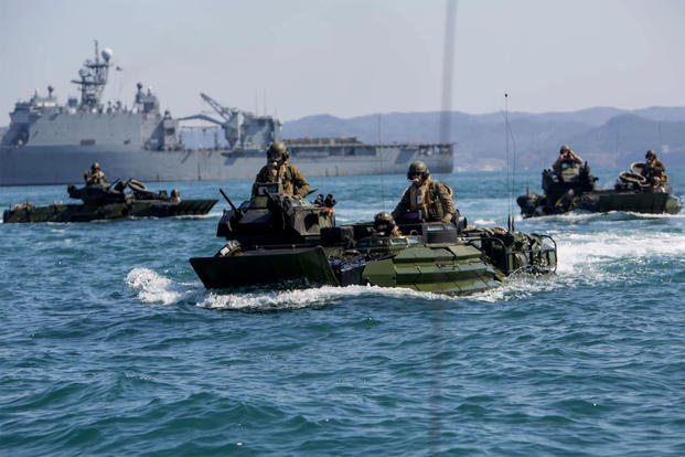 Marines with the 31st Marine Expeditionary Unit conduct a combined amphibious assault on Dogu Beach, South Korea, in AAV-P7/A1 amphibious assault vehicles as part of the Ssang Yong exercise in March 2016. (US Marine Corps photo/Carl King Jr.)