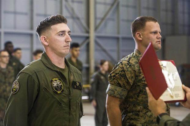 "Sgts. Ethan Mintus and Joseph Latsch were awarded the Navy and Marine Corps Achievement Medal with the newly authorized Remote Impact ""R"" Device  at Marine Corps Air Station Kaneohe Bay, Dec. 11, 2017. (Marine Corps photo)"