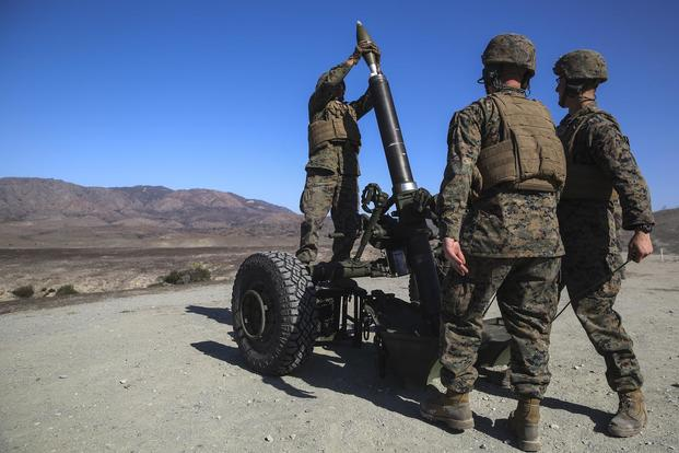 Marines with Battery B, 1st Battalion, 11th Marine Regiment, load an Expeditionary Fire Support System 120mm Mortar during a live fire demonstration at Marine Corps Base Camp Pendleton, Calif., on Nov. 17, 2016. The demonstration offered the opportunity to show the capability and mobility of the mortar system. Cpl. Timothy Valero/Marine Corps