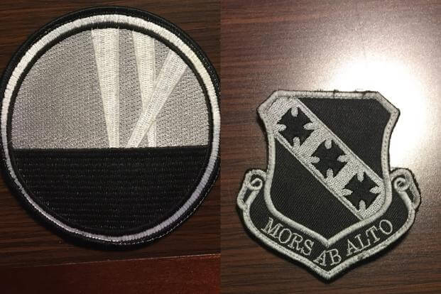 "L: 9th Bomb Squadron insignia shows spotlights representing the unit's three major World War I campaigns; R: ""Mors Ab Alto"" (death from above) patch representing 7th Bomb Wing. (Photo by Military.com/Oriana Pawlyk)"