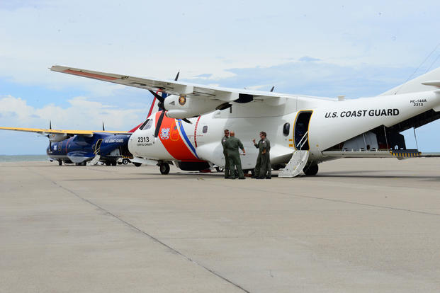 Coast Guard aviation crews prepare the HC-144 Ocean Sentry medium-range aircrafts for response efforts at Air Station Corpus Christi in Corpus Christi, Texas, Aug. 24, 2017. (U.S. Coast Guard photo/Johanna Strickland)