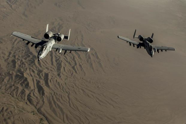 Two U.S. Air Force A-10 Thunderbolt II's with the 303rd Expeditionary Fighter Squadron fly in formation behind a KC-135 after conducting an air-to-air refueling over the skies of eastern Afghanistan, July 10, 2014. (U.S. Air Force/Senior Airman Matthew Bruch)
