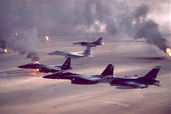 F-16A, F-15C and F-15E aircraft fly over Kuwaiti oil fires set by the retreating Iraqi army during Desert Storm. (U.S. Air Force/Fernando Serna)