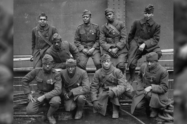 Some of the members of the 369th (15th N.Y.) Who won the Croix de Guerre for gallantry in action. Left to right. Front row: Pvt. Ed. Williams, Herbert Taylor, Pvt. Leon Fraitor, Pvt. Ralph Hawkins. Back row. Sgt. H. D. Prinas, Sgt. Dan Storms, Pvt. Joe Williams, Pvt. Alfred Hanley, and Cpl. T.W. Taylor; 1919 (National Archives/Unknown Photographer)