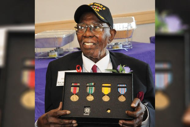 Richard Bell, a 99-year-old veteran and Blackstone resident, poses for pictures with medals he earned more than 72 years ago in World War II during a family reunion event Aug. 26, 2017, at the Eastern Henrico Recreation Center. (U.S. Army/Terrance Bell)