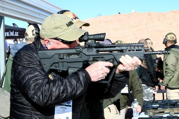Man tests the IWI US Tavor 7 rifle chambered for 7.62mm at range day during SHOT Show 2018. (Matthew Cox/Military.com)