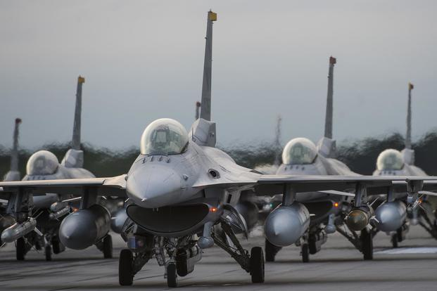 F-16 Fighting Falcons line the runway during an elephant walk at Misawa Air Base, Japan, on Sept. 16, 2017. Deana Heitzman /Air Force