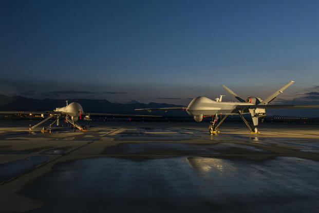 An MQ-1 Predator drone (left) and MQ-9 Reaper drone assigned to the 432nd Aircraft Maintenance Squadron remain ready for their next mission at Creech Air Force Base in Nevada. (US Air Force photo)