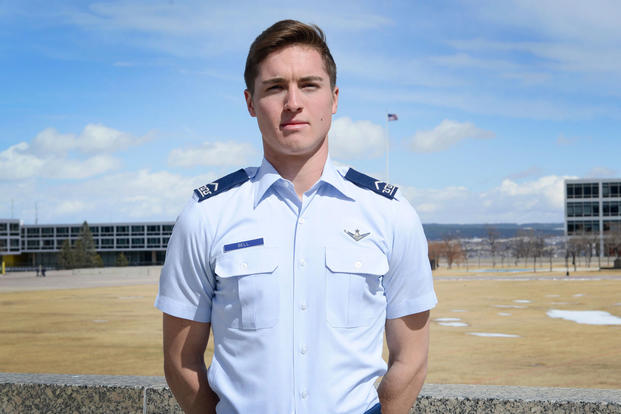 Cadet 3rd Class Jack Bell, Cadet Squadron 29, poses for a photo on the Terrazzo at the U.S. Air Force Academy, Colo., March 19, 2018. In the span of 72 hours, Bell talked a suicidal man off a Colorado Springs overpass and helped air traffic controllers in Northern California locate a downed aircraft. (U.S. Air Force photo/Charles Rivezzo)
