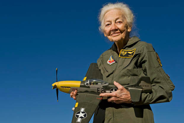 "Betty ""Tack"" Blake, 91, holds a model of a P-51 Mustang, her favorite aircraft to fly, in front of her home in Scottsdale, Ariz. Blake joined the first class of WAFs (later named Women Airforce Service Pilots). During World War II, she was assigned as a transport pilot, ferrying 36 different types of aircraft across America. (U.S. Air Force photo by Tech. Sgt. Bennie J. Davis III)"
