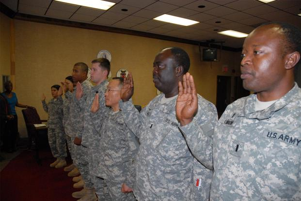 Soldiers take the oath of U.S. citizenship during a ceremony at the Post Conference Room at Fort Jackson. (US Army/Steve Reeves)