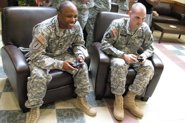 FILE PHOTO – Two soldiers compete in a video game tournament March 14, 2015 as part of the grand-opening activities for the new Warrior Zone at Torii Station. (U.S. Army/Katherine Belcher)