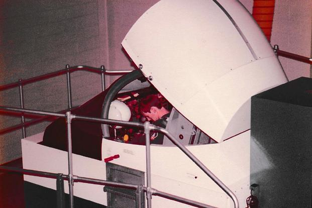 One of Eugene Taylor's trainees at Vance AFB, Oklahoma, straps into a flight simulator, circa 1978-79. (Photo courtesy of Eugene Taylor)