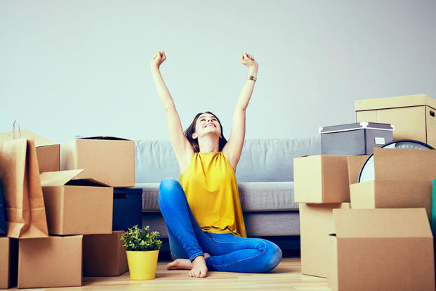 Woman with couch and moving boxes