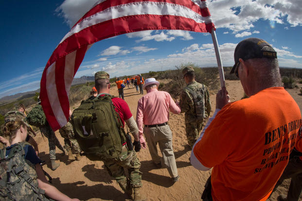 100-year-old Bataan Death March survivor Col. Ben Skardon, a beloved Clemson University alumnus and professor emeritus, walks in the Bataan Memorial Death March at White Sands Missile Range, N.M., for the 11th time, March 25, 2018. Skardon walked nearly 7 of his typical 8.5 miles. (Photo: Ken Scar/U.S. Army)