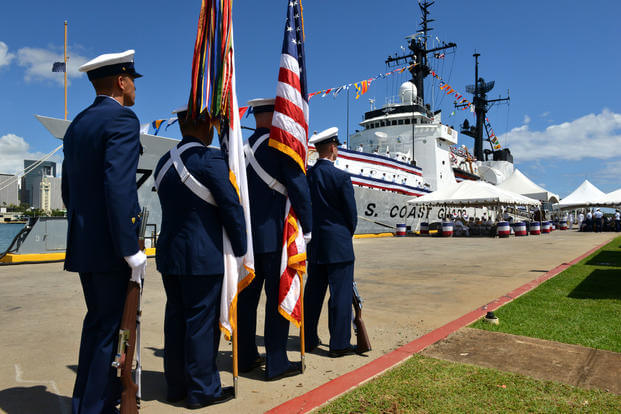 Members of the U.S. Coast Guard ceremonial honor guard stand in front of the Coast Guard Cutter Sherman prior to the cutter's decommissioning ceremony in Honolulu, Mar. 29, 2018. The Sherman was decommissioned after nearly 50 years of meritorious service to the United States. (U.S. Coast Guard photo/Matthew S. Masaschi)