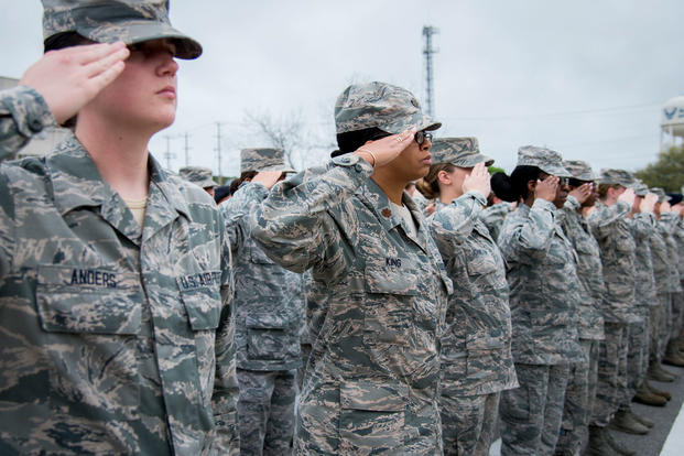 The all-female formation salutes during the national anthem at the base retreat ceremony at Eglin Air Force Base, Fla., March 30, 2017. (U.S. Air Force photo/Samuel King Jr.)