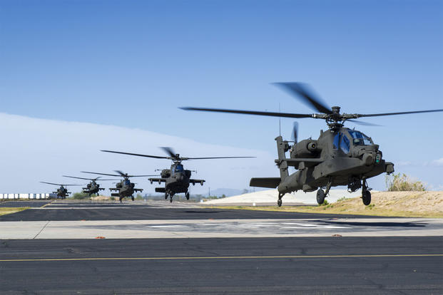 A flight of five U.S. Army AH-64 Apache helicopters takes off.  (US Army photo)