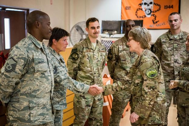 U.S. Air Force Lt. Gen. Maryanne Miller (right), commander of the Air Force Reserve Command, greets airmen from the 379th Expeditionary Air Mobility Squadron, at Al Udeid Air Base, Qatar, Dec. 12, 2017. (U.S. Air National Guard/Master Sgt. Phil Speck)