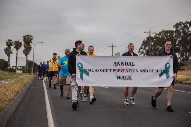 U.S. Marines and Sailors with 1st Marine Logistics Group participate the Sexual Assault Prevention and Response Walk at Camp Pendleton, Calif., April 27, 2018. (U.S. Marine Corps/Pfc. Timothy Shoemaker)
