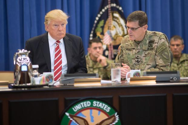 FILE PHOTO -- President Donald Trump discusses current military operations with Gen. Joseph Votel, commander of U.S. Central Command Commander, at MacDill, AFB, FL, Feb. 6, 2017. (DoD/D. Myles Cullen)