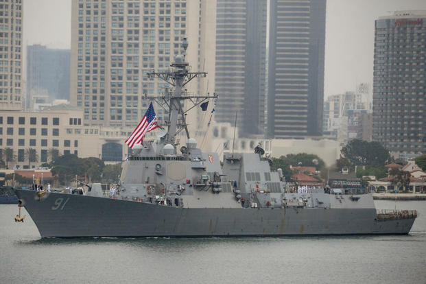 The guided-missile destroyer USS Pinckney (DDG 91) transits the harbor as it departs for deployment, June 5, 2017, in San Diego. (U.S. Navy photo/David Claypool)