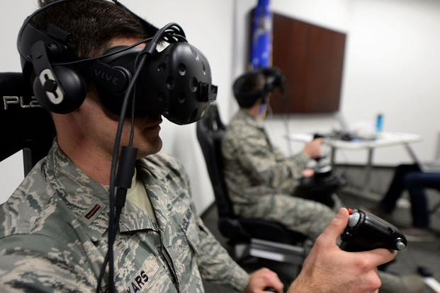Second Lt. Kenneth Soyars, 14th Student Squadron student pilot, takes off during a virtual reality flight simulation Jan. 10, 2018, at Columbus Air Force Base, Miss. Two subjects flew at a time but no other subjects were allowed to watch or learn from other individuals' sorties. The Adaptive Flight Training Study pushed subjects to learn through the VR technology. (Keith Holcomb/U.S. Air Force)