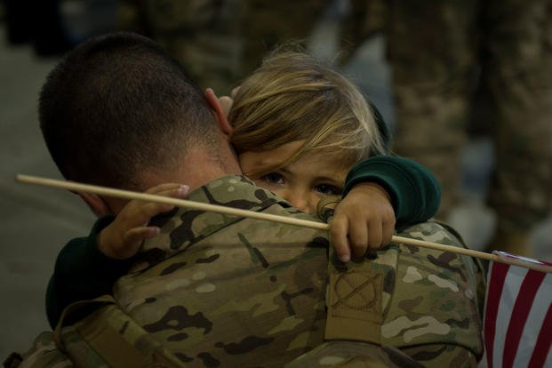 A child hugs his father for the first time in months after returning from a deployment at Hurlburt Field, Fla., Dec. 7, 2017. (U.S. Air Force photo/Dennis Spain)