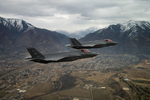 Two U.S. Air Force F-35A Lightning IIs, assigned to the 4th Fighter Squadron from Hill Air Force Base, Utah, fly over the base and the surrounding area on Feb 14, 2018. (U.S. Air Force photo/Andrew Lee)