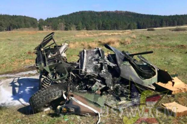 End result: The mangled remains of the Humvee on the ground in Germany after crashing from hundreds of feet in the air. (Posted to Facebook by US Army W.T.F.! Moments)