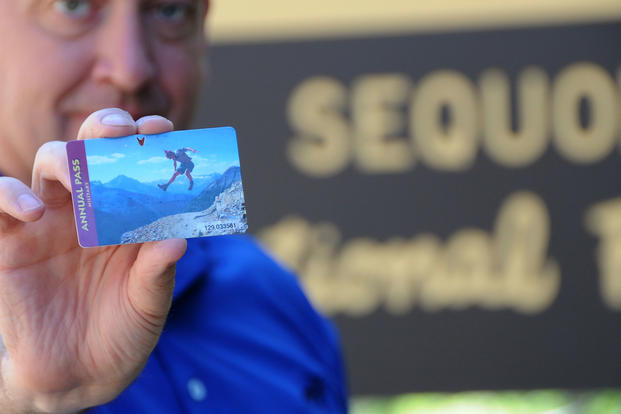 Master Sgt Vincent De Groot, of the Iowa Air National Guard, displays an Annual Pass to the National Parks he picked up during a recent visit to Sequoia National Park in California. (U.S. Air Force)