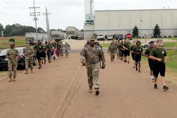 A drill sergeant with the Mississippi National Guard Recruiting and Retention Battalion leads the warriors of the Senatobia Recruit Sustainment Program during a road march Oct. 7, 2017. (U.S. National Guard/Staff Sgt. Scott Tynes)