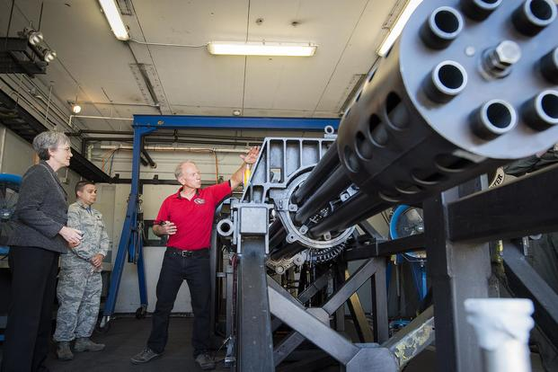 Secretary of the Air Force Heather Wilson learns about the GAU-8 30-millimeter cannon from Bob DuPont of the 780th Test Squadron on May 4 at Eglin Air Force Base. Samuel King Jr./Air Force