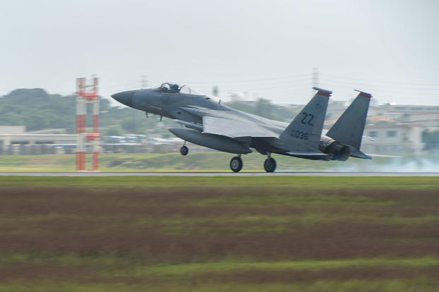 A U.S. Air Force F-15 Eagle from the 67th Fighter Squadron lands on the runway Nov. 16, 2016, at Kadena Air Base, Japan. (U.S. Air Force photo/Corey M. Pettis)