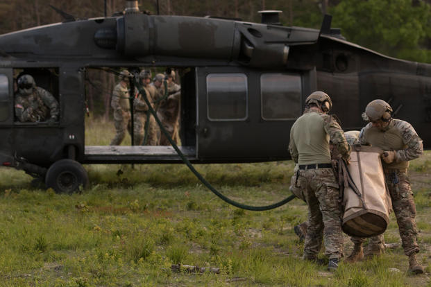 Soldiers from the 20th Special Forces Group, Massachusetts National Guard practice fast roping out of a UH-60 Black Hawk from the 3rd Battalion 126th Aviation Regiment, June 7, 2018. (U.S. Army National Guard photo/Steven C. Eaton)
