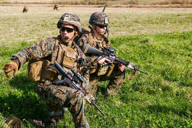 Then-1st Lt. Patrick Nugent, a platoon commander with Charlie Company, Battalion Landing Team 1st Battalion, 5th Marines, 31st Marine Expeditionary Unit, directs his Marines into their positions during an assault on the airfield at the Ie Shima Training Facility, Okinawa, Japan, Feb. 12, 2016. (U.S. Marine Corps photo/Zachary Dyer)