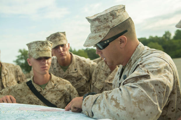 Then-Staff Sgt. Shawn C. Moulton explained motor transportation at Fort A.P. Hill, Virginia, on Sept. 3, 2014. Prosecutors accuse him of fraternizing with a junior Marine, which is banned by military law. (U.S. Marine Corps photo/Desire M. Mora)